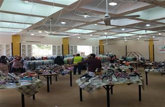 توزيع ملابس وأحذية جديدة على 300 من الأسر الأكثر احتياجًا بالغربية | صور