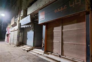 تحرير محاضر إشغال وإغلاق محال بمدينة إسنا في الأقصر | صور