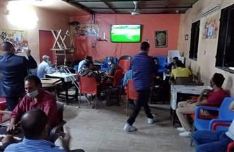 إغلاق مقهى بمدينة موط بالوادي الجديد  لمخالفتة الإجراءات الاحترازية   صور
