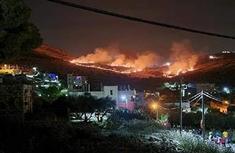 مستوطنون إسرائيليون يحرقون مساحات من أراضي بلدة فلسطينية في نابلس