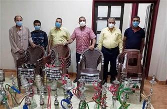 مصادرة 97 شيشة وغلق 8 مقاهٍ مخالفة وتحصيل غرامات فورية لعدم ارتداء الكمامة بسوهاج | صور