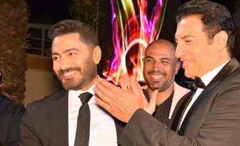 تامر حسنى يشارك جمهوره صور حفل زفاف ابن مصطفى قمر|صور