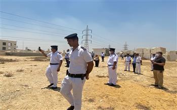 جهاز القاهرة الجديدة يسترد 9 أفدنة شمال طريق العين السخنة بالتعاون مع الشرطة|صور