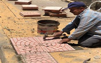 حي العجوزة ينفذ أعمال صيانة بالصرف الصحي |صور