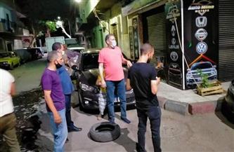 حملات لرفع القمامة والإشغالات والتشجير بشوارع حي شرق أسيوط   صور