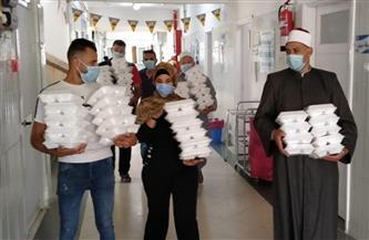توزيع وجبات على مرضى الحميات والأورام بدمياط | صور