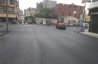 رصف تفريعات ميدان البنوك بحي غرب أسيوط | صور