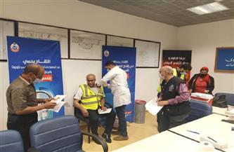 تطعيم العاملين بمطار الأقصر بلقاح كورونا استعدادًا للموسم السياحي الجديد | صور