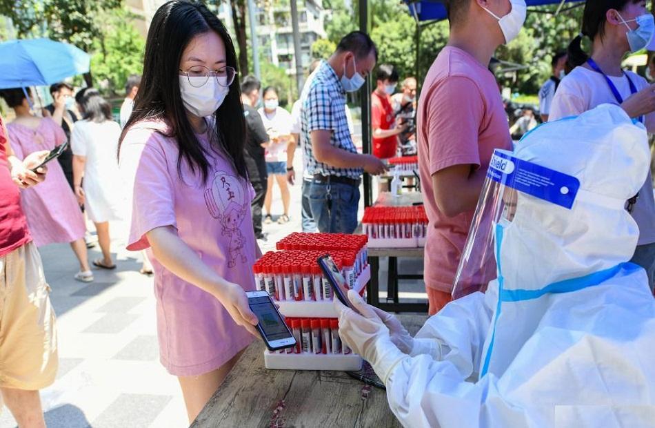 الصين إعطاء  مليار جرعة من اللقاح المضاد لفيروس  كورونا
