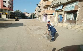 عمال-النظافة-في-كفر-الشيخ-يرتدون-الزي-الجديد-خلال-حملة-نظافة-بشوارع-بيلا -صور
