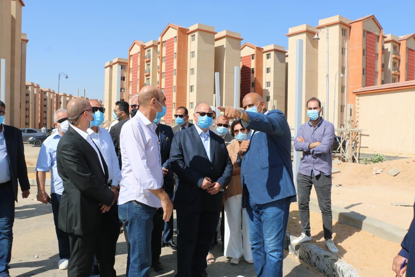 قوامها  وحدة سكنية  معا  مدينة حضارية كاملة الخدمات لقاطني العشوائيات بالقاهرة |صور