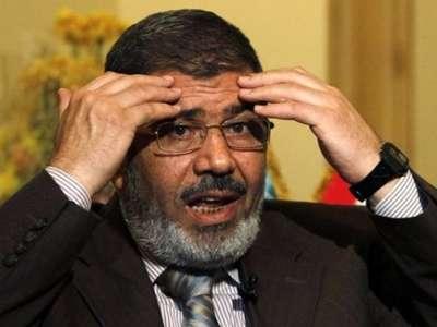 قضية اليوم يكتبها : أحمد البرى .. محاكمة علنية لمحمد مرسى