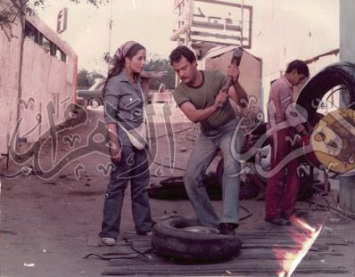 بوسى مع فاروق الفيشاوى فى فيلم لعبة الكبار .